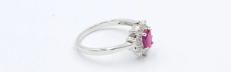 a white gold and ruby engagement ring on a white background