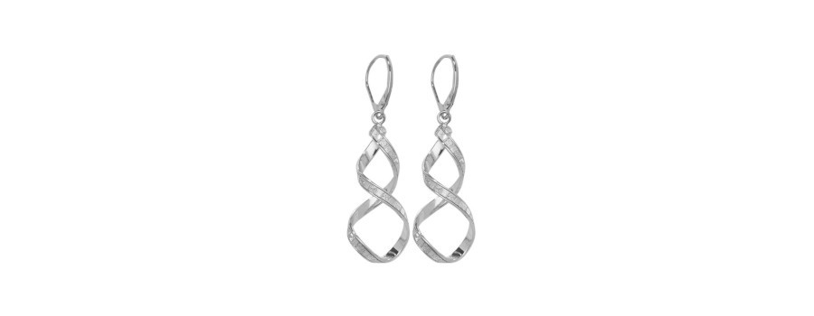 a set of white gold twisted drop earrings on a white background