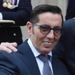 a photo of christy dignam showing the new diamond on his tooth