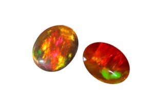loose red and orange fire opal gemstones on a white background