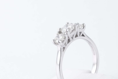 a white gold multi-diamond engagement ring on a white background
