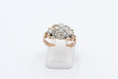 an antique style rose gold engagement ring with a cluster of diamonds