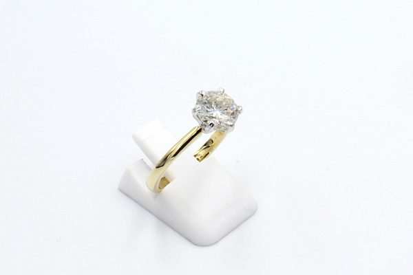 gold solitaire diamond engagement ring side