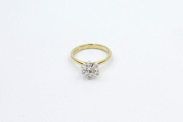 gold solitaire diamond engagement ring top