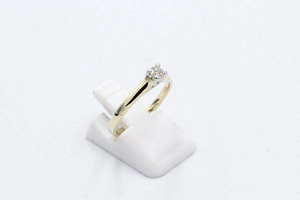 gold solitaire diamond ring side