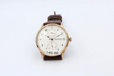 a gold dalton wrist watch witha  leather strap on a white background