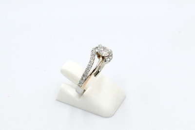 a repaired engagement ring with the missing part of the band added back in