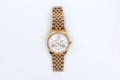 a rose gold dalton wristwatch on a white background