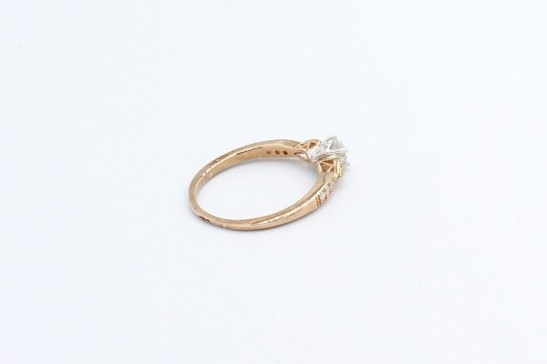 rose gold solitaire engagement ring 4