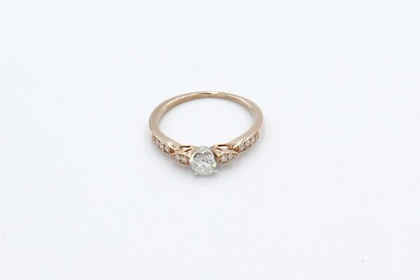 solitaire diamond rose gold ring top