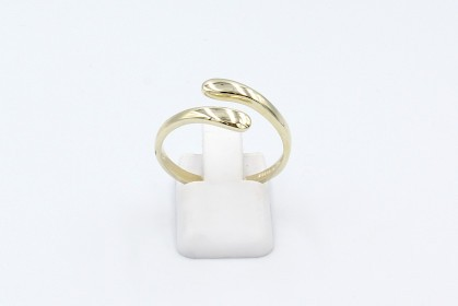 a yellow gold thumb ring on a white background