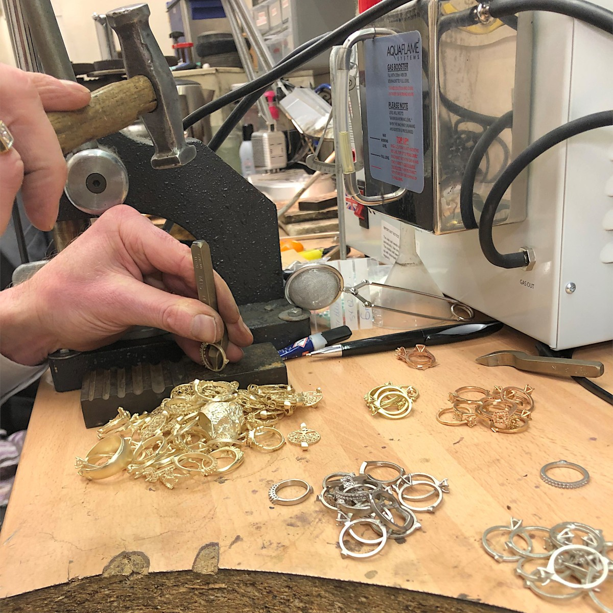 martin gear working on raw gold ring castings