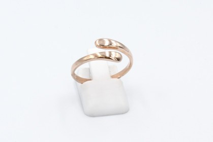 a rose gold thumb ring on a white background