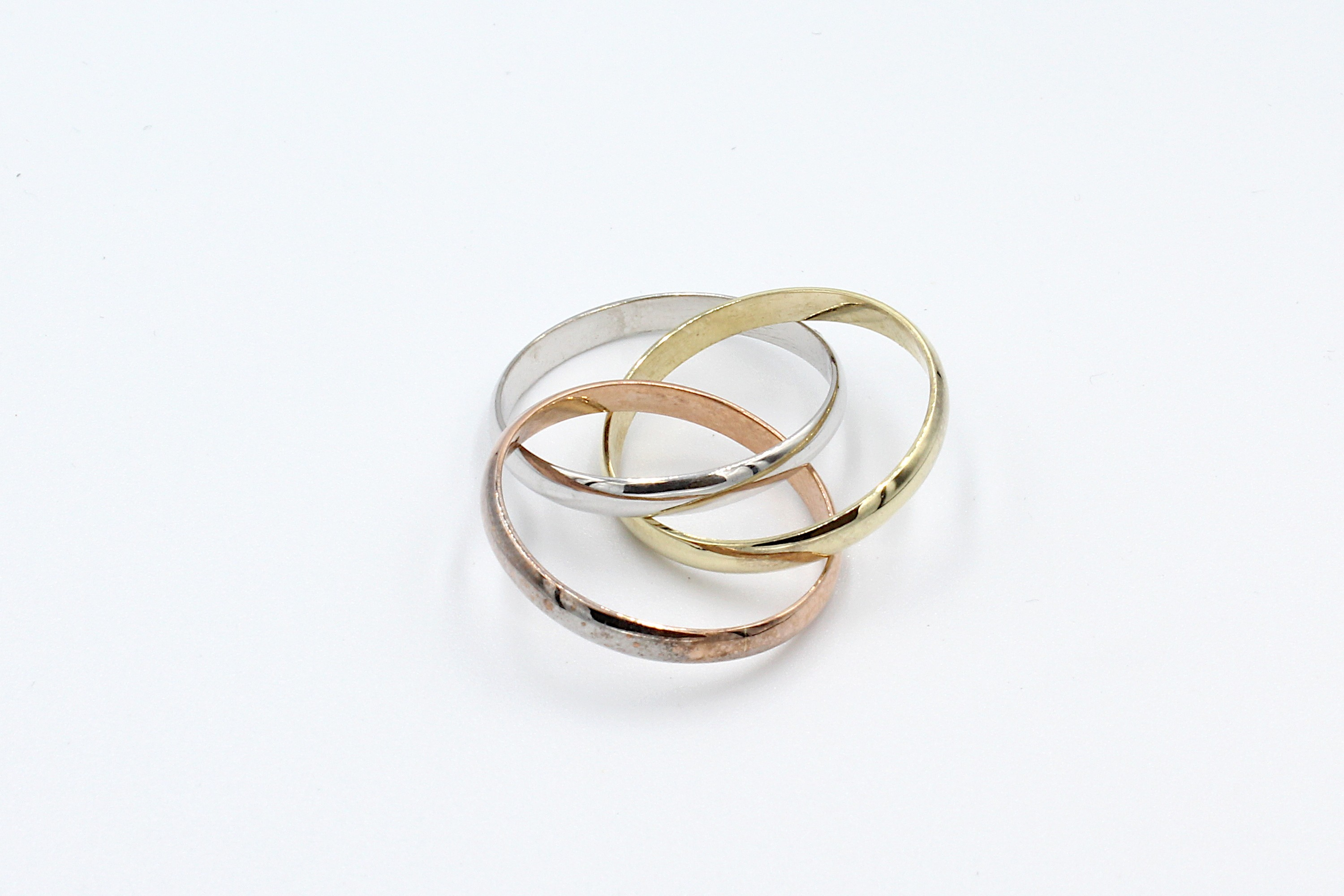 a trio russian wedding ring bands on a white background