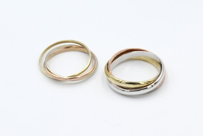 two sets of russian wedding rings on a white background