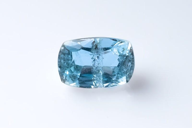 a single aquamarine gemstone on a white background