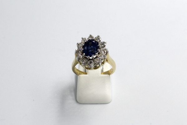 front view of a gold sapphire and diamond cluster engagement ring