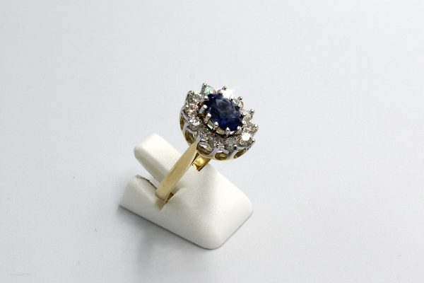 side view of a gold sapphire and diamond cluster engagement ring