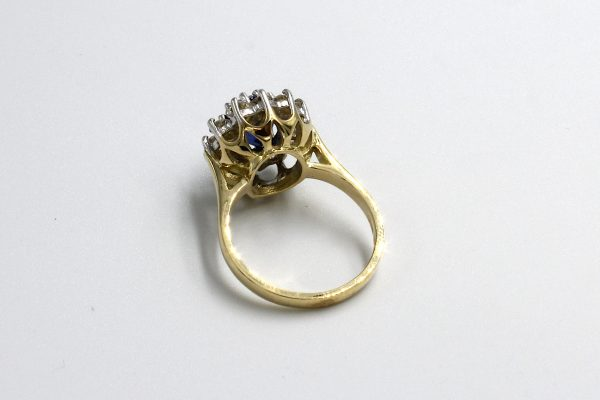 rear view of a gold sapphire and diamond cluster engagement ring