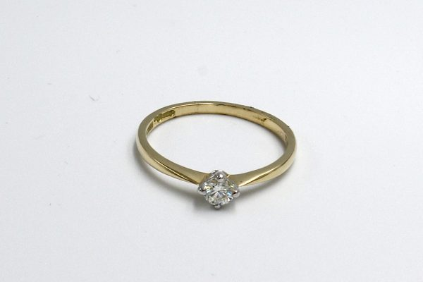 top view of a gold and and diamond illusion ring