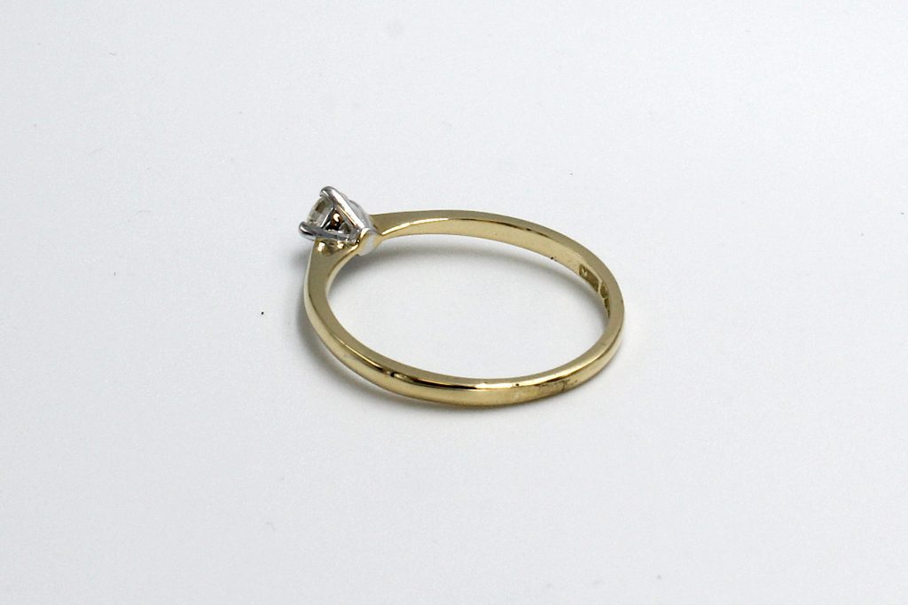 rear view of a gold and and diamond illusion ring