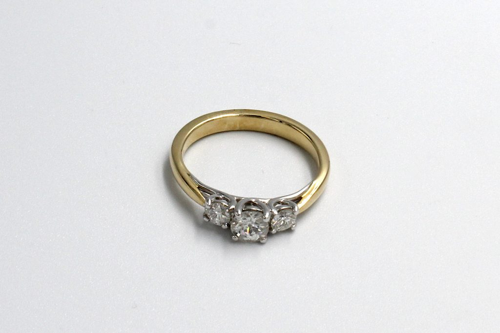 top view of a multi-diamond and gold engagement ring