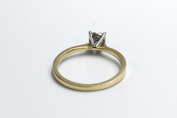 back view of a gold and and diamond illusion ring