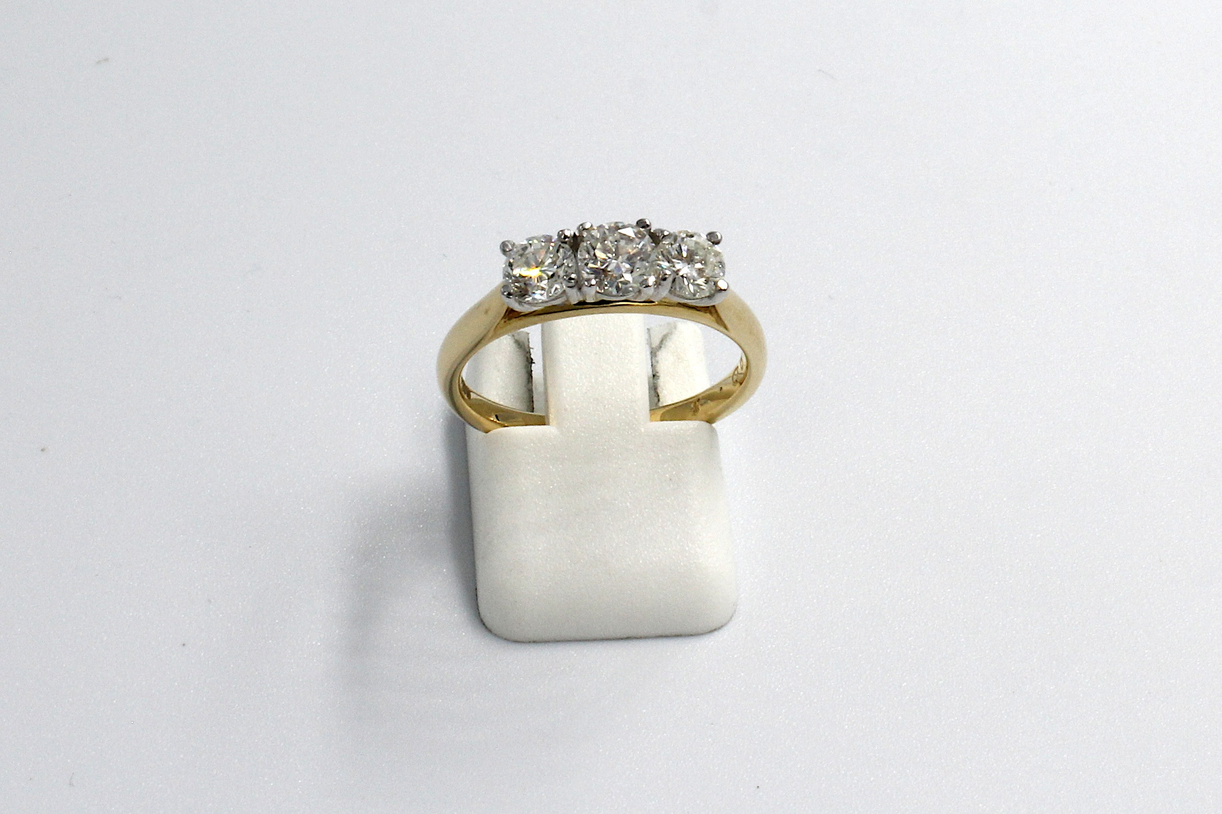 front view of a multi-diamond and gold engagement ring