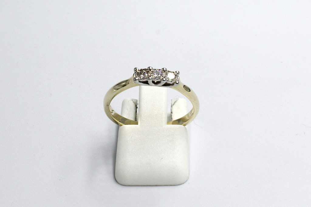 front view of a multi-diamond illusion setting engagement ring