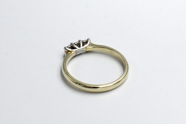 rear view of a multi-diamond illusion setting engagement ring
