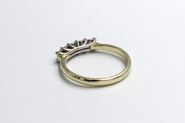 rear view of a multi-diamond and gold engagement ring