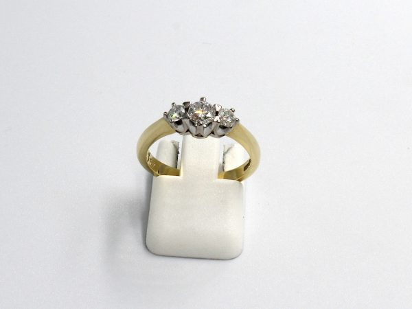 front view of a gold multi-diamond engagement ring