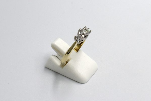 side view of a gold multi-diamond engagement ring