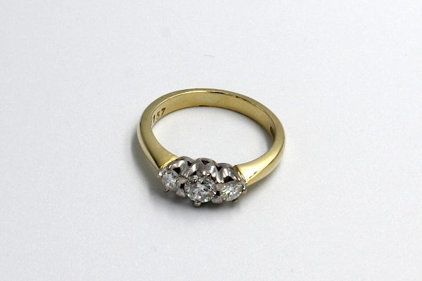 top view of a gold multi-diamond engagement ring
