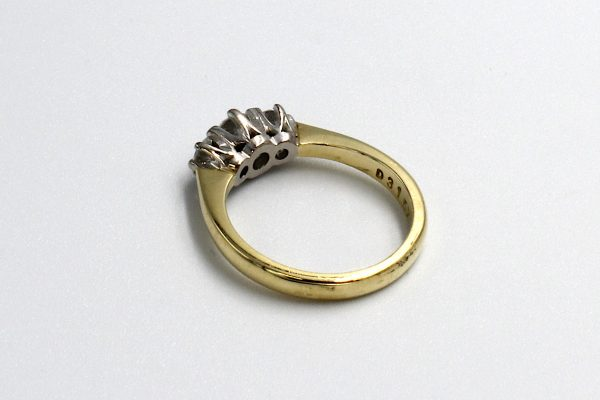 rear view of a gold multi-diamond engagement ring