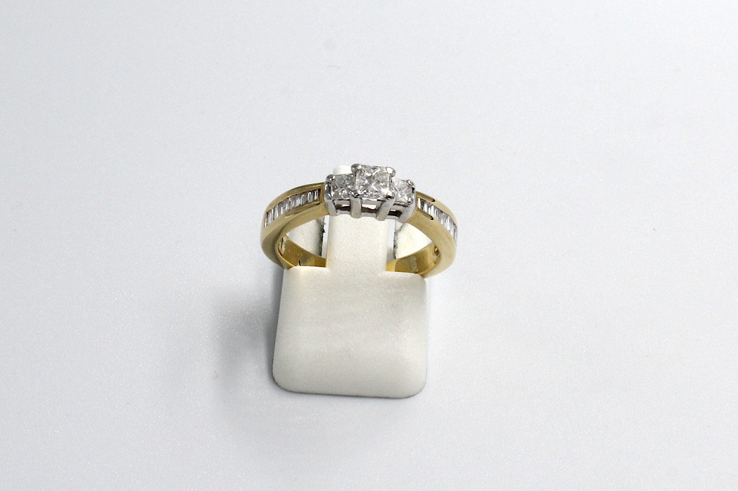 front view of a princess and baguette multi-diamond ring