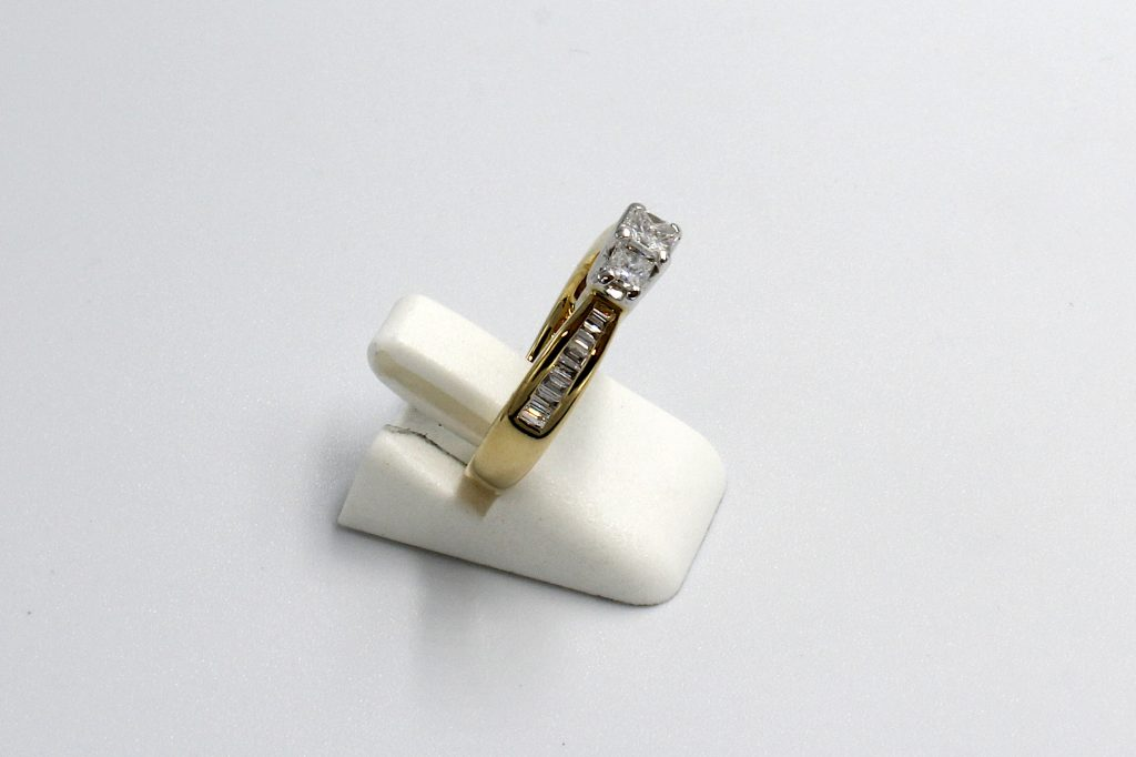 side view of a princess and baguette multi-diamond ring