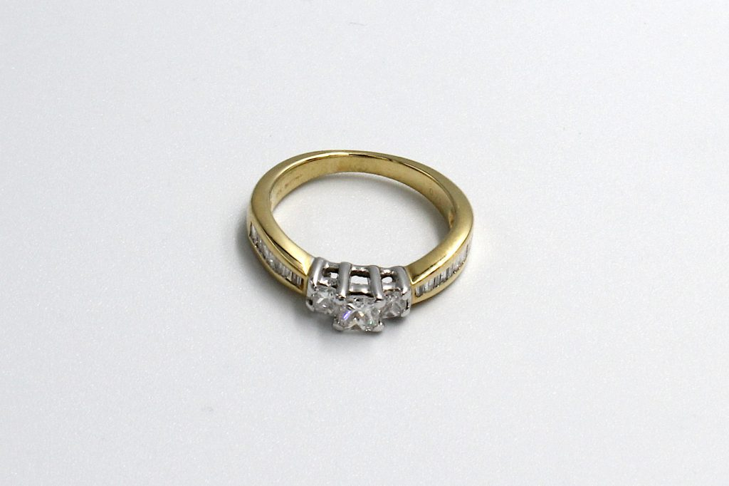 top view of a princess and baguette multi-diamond ring