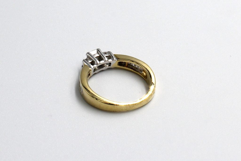 rear view of a princess and baguette multi-diamond ring