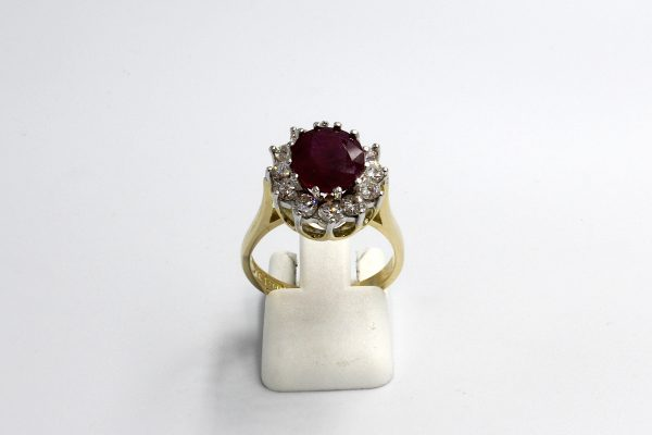 front view of a ruby and diamond cluster engagement ring