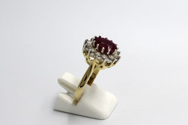 side view of a ruby and diamond cluster engagement ring