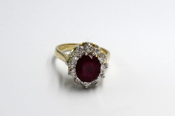 top view of a ruby and diamond cluster engagement ring