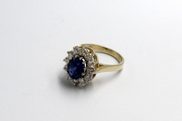 top view of a gold sapphire and diamond cluster engagement ring