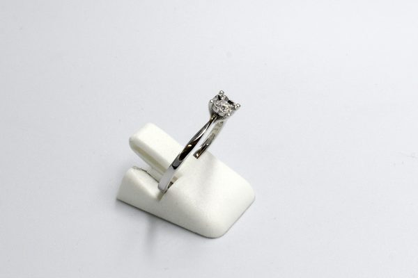 side view of a white gold diamond illusion set engagement ring