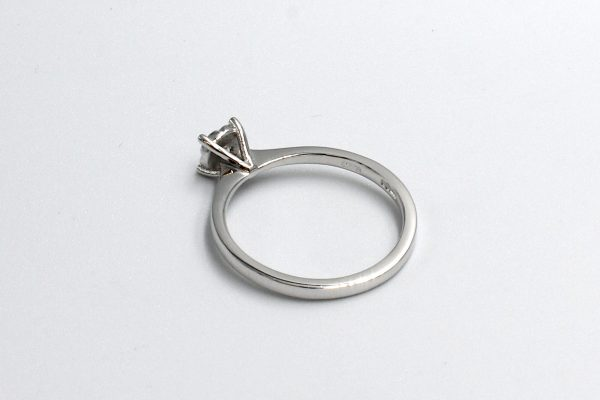 rear view of a white gold diamond illusion set engagement ring