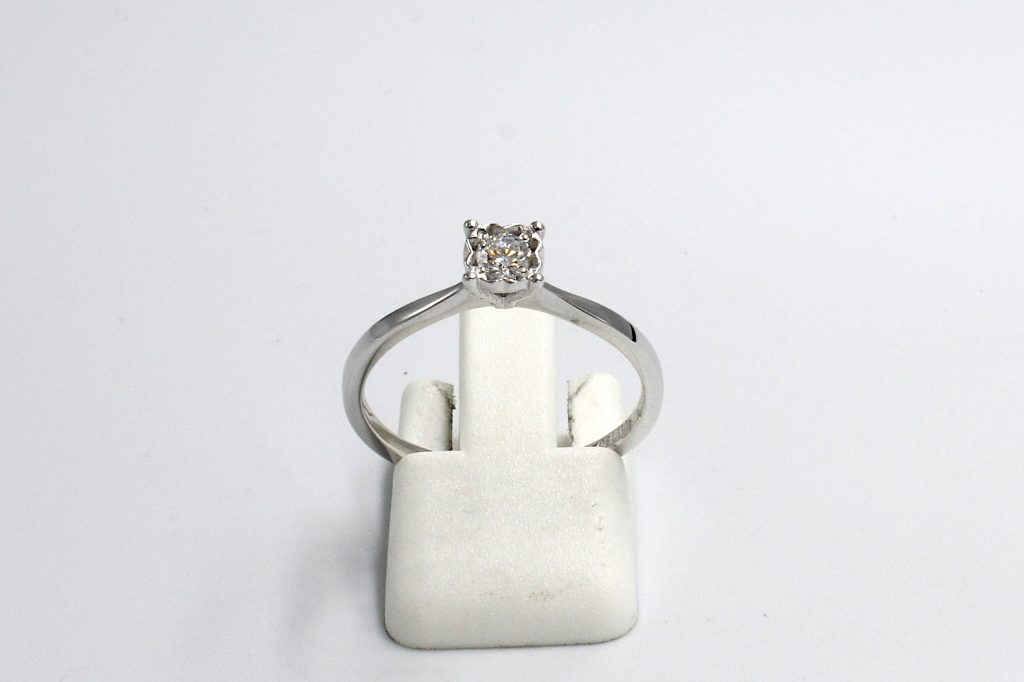 front view of a white gold diamond illusion engagement ring
