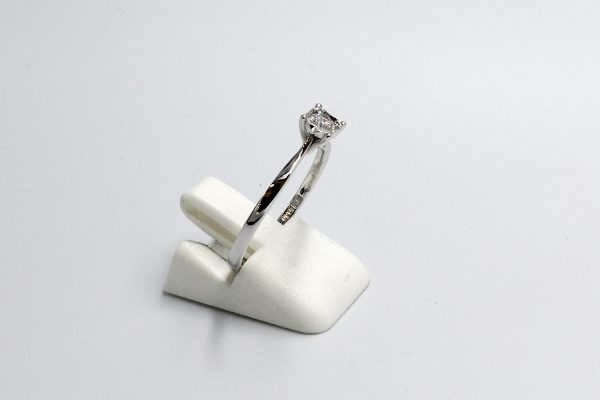 left view of a white gold diamond illusion engagement ring
