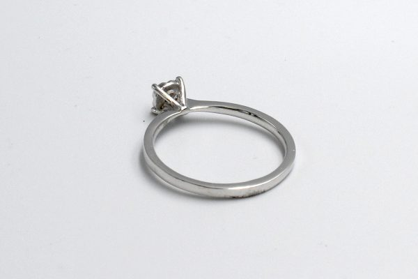 rear view of a white gold diamond illusion engagement ring