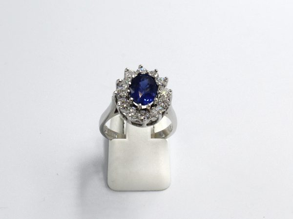 front view of a white gold diamond and sapphire cluster engagement ring