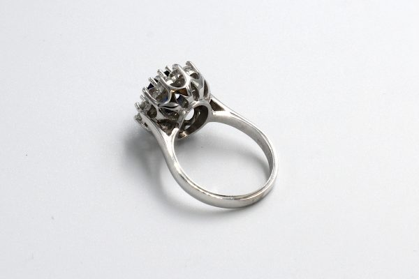 rear view of a white gold diamond and sapphire cluster engagement ring